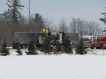 A double load tractor trailer en route from British Columbia to Brockville caught fire while travelling along Highway 417 in West Carleton Nov. 30 when the tires of truck caught fire. This ignited the load western cedar being carried by the truck. No injuries were reported.