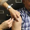A man receives his flu shot.