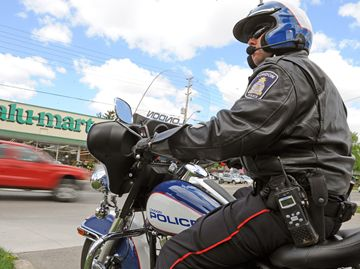 Const. Veerman observes the actions of drivers as they pass by.