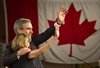 Liberal Leader Michael Ignatieff and his wife Zsuzsanna Zsohar take the stage Monday in Toronto as the Liberals faced their worst election showing ever.