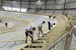 Work crews busy installing Velodrome's wooden race floor at