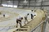 Work crews busy installing Velodrome's wooden race floor