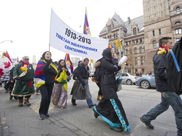 Supporters of Tibetan independence march on Queen Street Wednesday morning for a celebration rally to mark the 100th anniversary of Tibetan Proclamation of Independence. (Feb. 13, 2013)
