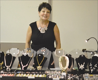 The 25th annual Women's Fair benefitting Interval House was held Nov. 2 in Carleton Place. Dozens of excited shoppers lined up as early as one hour before its opening to make sure they had a head start in viewing the dozens of vendor's tables. Maggie Lewis had a wide variety of her handmade statement jewelry on display at the fair.