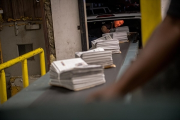 In this June 26, 2018 file photo, newspapers are bundled after being printed in Louisville, Ky., June 26, 2018. The Trump administration's decision to impose tariffs on Canadian newsprint is hastening the demise of local newspapers across the U.S.