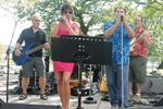 Passport entertains Midland fans at Music in the Park
