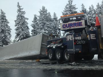 Tractor trailer in ditch along southbound Hwy. 400 south of Innisfil Beach Road
