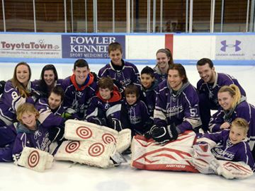 Members from the Western Mustangs men and women's hockey teams pose for a picture at centre ice with the youth involved in the greater London Hockey Association (GLHA). It was announced Wednesday (April 16) Western and the GLHA have teamed up to create 16 Seeded AA/A level teams called the Jr. Mustangs.