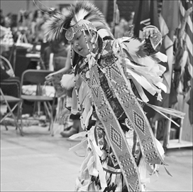 Theland Kicknosway performs a dance at the annual Ottawa Children and Youth Traditional Powwow at Carleton University on March 29. Theland, 10, lives in Nepean but is from Walpole Island. The powwow featured dances, as well as traditional crafts for sale.