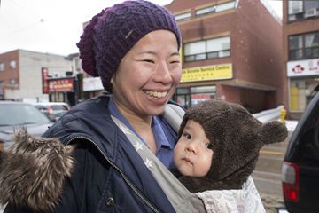 Wendy Leung and her daughter, eight-month-old Nora Murphy, join the Chinese New Year celebrations along Gerrard Avenue in East Chinatown Feb. 2.