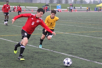 The St. Marcellinus Spirit hosted their fifth annual Friday Night Lights soccer triple header last night. The Spirit's Nick Tsekouras goes after the ball with Adrian Popa of the Philip Pocock Pirates also in pursuit in the junior boys' contest.