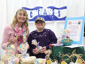 Diane Kruck and Anne Morton sold all natural dog cookies for Community Living Association South Simcoe.