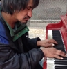 Dishevelled man wows crowd on street piano-Image1
