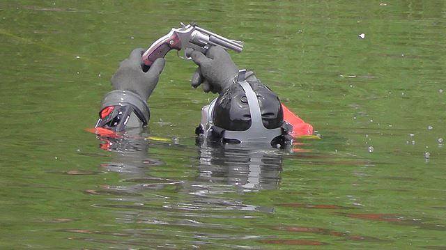 Divers find gun