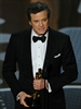 Colin Firth accepts the award for Best Performance by an Actor in a Leading Role for 'The King's Speech.'