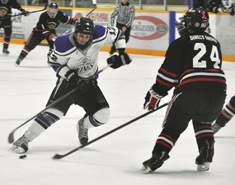 Penetang Kings forward Ryan Shaw tries to deke around Schomberg Cougars defenceman Bobby Quinn during Game 3 of the Georgian Bay Mid-Ontario Junior C Hockey League semifinal on Monday. The visiting Cougars won 4-3.
