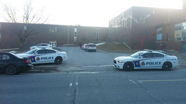 Police cars outside Adam Scott Collegiate - April 1, 2015