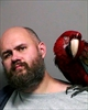 Macaw poses in man's mug shot after unlucky court appearance-Image1