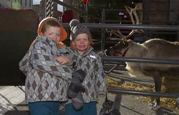 Brothers, Ty and Jackson got bundled up to brave the cold and visit with Santa's reindeer.