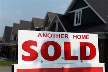 CMHC raises risk rating for housing market-Image1