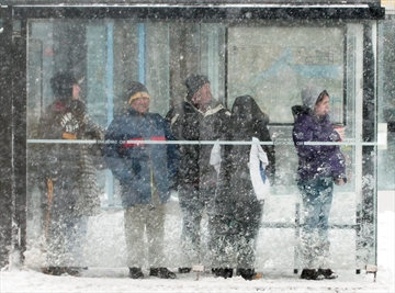 In this file photo, commuters wait for a bus in the protection of the shelter at James Street at King.