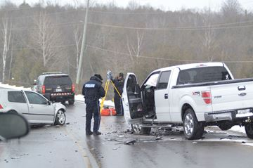 OPP Technical Traffic Collision investigators reconstruct the scene of a fatal crash on Kawartha Lakes Road 8 at Sturgeon Point Road on March 20. Police say Alex Stephenson, 21 died of his injuries in hospital.Mary Riley/This Week