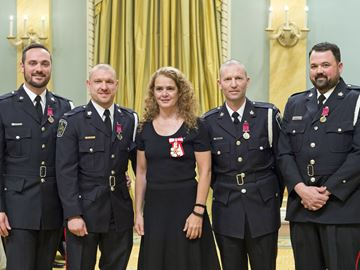 Governor General Julie Payette presents bravery awards on Nov. 23 at Rideau Hall to four Niagara Regional Police officers who were involved in a shootout with a suicidal, armed man in 2015. Shown with Payette from left are constables Allan Rivet, Jacob Braun, Neal Ridley and Daniel Bassi.