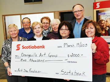 Orangeville Art Group members accepted a cheque for $2,000 from Scotiabank on Friday (March 15). The bank's donation matched proceeds from the art group's 43rd annual show and sale.