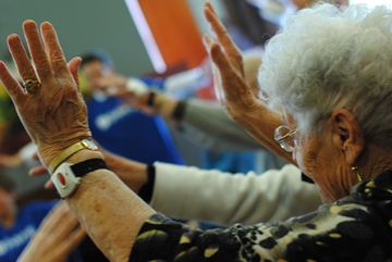 A woman participates in  group exercise at Dolce Vita Retirement Living April 14.