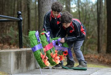 Joey Pellegrini and David Pellegrini lay the Township of King wreath during the Kettleby Service of Remembrance at the cemetery cenotaph, Sunday. (Nick Iwanyshyn/York Region Media Group)