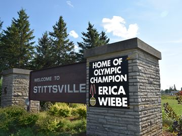 Signs in community congratulating Erica Wiebe