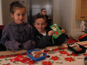 Here, Rachel Paiva, 7, and Gavin Paiva, 5, make holiday crafts at the BWG Leisure Centre's festive family fun day Saturday afternoon.