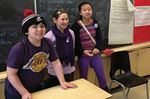 Students show their support on Purple Day