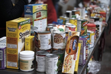 Volunteers sort through donated food during the annual Fall Food Drive at North York Harvest Food Bank last October in this file photo.