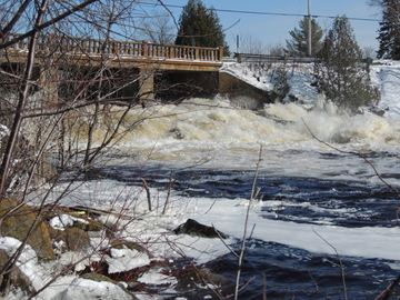 One local sure sign of spring is the serious melt water flow through the Hurdville dam. Parts strewn about for the Bell communications tower being built off Centre Road east of Stewart Park Drive.