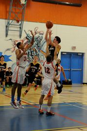 Innisdale's Julian Walker (34) Collingwood's Carter McDonald (4) and Innisdale's Nick Klein (12).