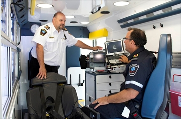 Chris Barry, Peterborough County-City Paramedics deputy chief of operations, left, and Jeff Wilson, superintendent, check out the inside of a new custom-designed ambulance at Peterborough Paramedic headquarters in Peterborough, Ont. on Friday, June 15, 2018. Peterborough Paramedics bought three new ambulances that are the first of their kind in North America.