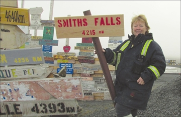 Smiths Falls directional sign is on top of the world– Image 1