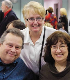 Dan Shipley, left, Suzan Prioux and Tina Delaney enjoy a hot breakfast at the Vanier Community Service Centre's annual Snowflake Breakfast to help raise money for the local food bank, Partage Vanier, on Dec. 6.