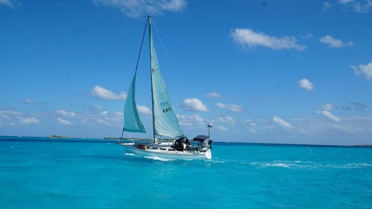 Sail, work, save money, sail