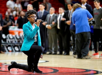 Anthem singer at Heat-76ers game kneels during performance-Image1
