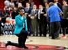 Anthem singer at Heat-76ers game kneels during performance-Image1