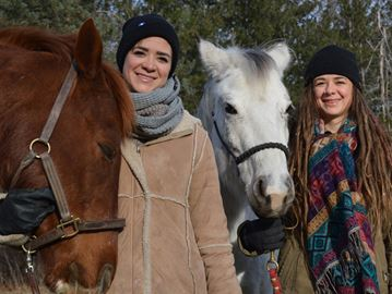 From Left, Katie Keča, 23, and her horse Lux, Jewel Keča, 18 and Ora, her horse.