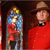 People line procession route for funeral of slain Mountie