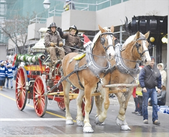 The annual Christmas parade was held downtown Ottawa on Nov. 23. As the parade started, so did the well timed snow, covering floats and firefighters. The Help Santa Toy Parade is organized by the Ottawa Professional Firefighters Association annually, and raises money to purchase toys for less fortunate children in the Ottawa area.