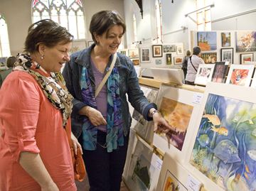 Dianne Regier and Susan Leckie discuss various techniques used by some of the artists who's work was on display as part of the 42nd annual Brush and Palette Club Show and Sale.