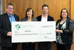 United Way accepts $21,733 cheque from C.C. Tatham firm