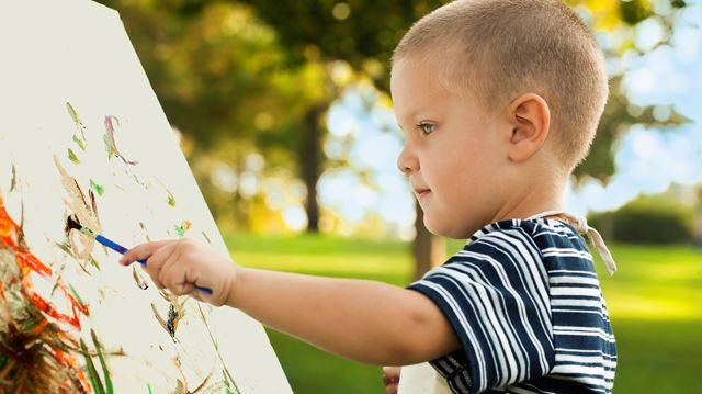 Kid Painting Outside
