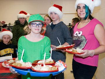 Students serve up festive meal to raise funds and support food bank