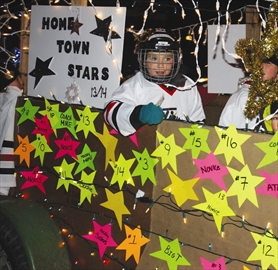 Participants in Colborne's annual Santa Claus parade, including members of the Colborne-Cramahe Figure Skating Club, braved a cold wind during their night-time procession Nov. 23.